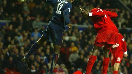 Liverpool's Emile Heskey leaps above Arsenal's Lauren to head an injury-time equaliser at Anfield in