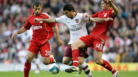 Liverpool's Xabi Alonso (right) and Javier Mascherano battle for the ball with Arsenal's Cesc Fabreg