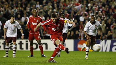 Liverpool's Steven Gerrard scores from the penalty spot to beat Arsenal in the Champions League at A
