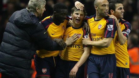 Arsenal boss Arsene Wenger joins in the celebrations after one of Andrey Arshavin's four goals again