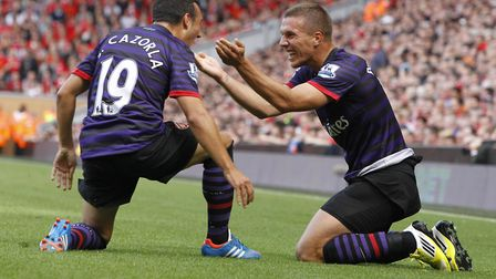 Arsenal's Santi Cazorla and Lukas Podolski both scored in their win at Anfield in 2012 (pic Peter By