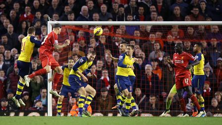 Liverpool's Martin Skrtel (second from left) scores his side's injury-time equaliser against Arsenal