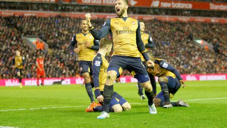 Arsenal's Olivier Giroud celebrates scoring his side's third goal of the game at Anfield in 2016 (pi