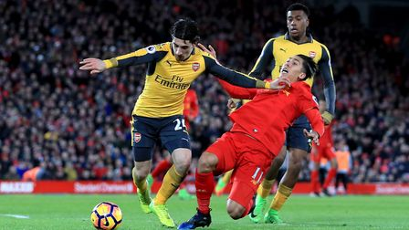 Arsenal's Hector Bellerin (left) and Liverpool's Roberto Firmino (right) battle for the ball during