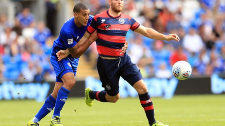 Cardiff City's Lee Peltier (left) and Queens Park Rangers' Conor Washingto battle for the ball (pic
