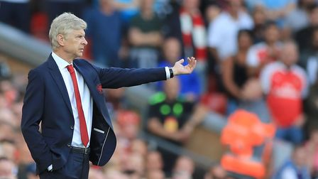 Arsenal manager Arsene Wenger gestures on the touchline during the Premier League match at Anfield,