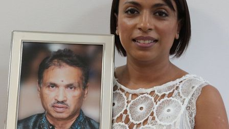 Shila Rabadia with a picture of her father Naran Rabadia who had his organs donated following his de