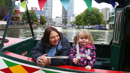 Millie Hyde, 2, looks out from a boat with grandmother Jacky Linsey at Angel Canal Festival. Picture