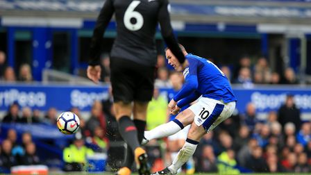 Everton's Wayne Rooney scores his side's first goal of the game during the Premier League match at t