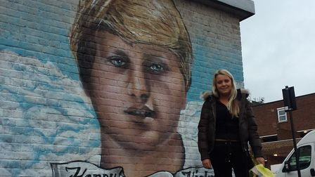 Claudia Hicks in front of the Wheelwright Street mural of her brother, Henry Hicks. Picture: David L