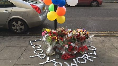Flowers and tributes left at the scene of the killing.