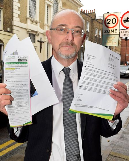 Angus Hamilton with the £50 fine he received for putting his recycling out. Picture: Polly Hancock