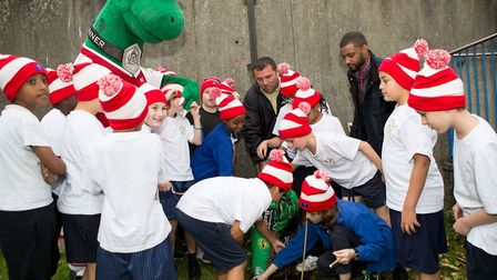 Students at St Andrew's Primary School are given a helping hand in the garden by Gunnersaurus (left)