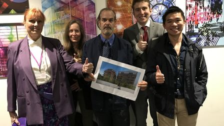 Victorious Kensal Green councillors Claudia Hector, Matt Kelcher and Jun Bo Chan with local resident