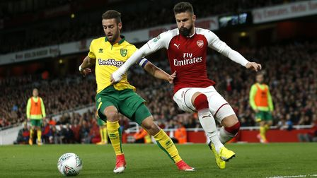 Norwich City's Ivo Pinto (left) and Arsenal's Olivier Giroud (right) battle for the ball during the