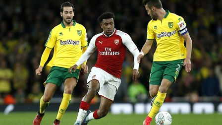 Norwich City's Mario Vrancic (left) and Daniel Ivo Pinto (right) battle for the ball with Arsenal's