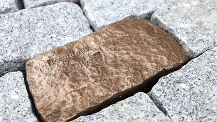Musson and Retallick propose installing polished bronze paving stones containing the words and stori