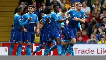 Arsenal's Per Mertesacker (right) celebrates scoring his side's first goal of the game during the Pr