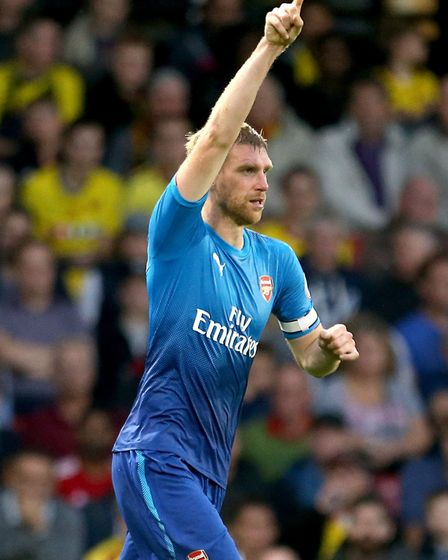 Arsenal's Per Mertesacker celebrates scoring his side's first goal of the game during the Premier Le