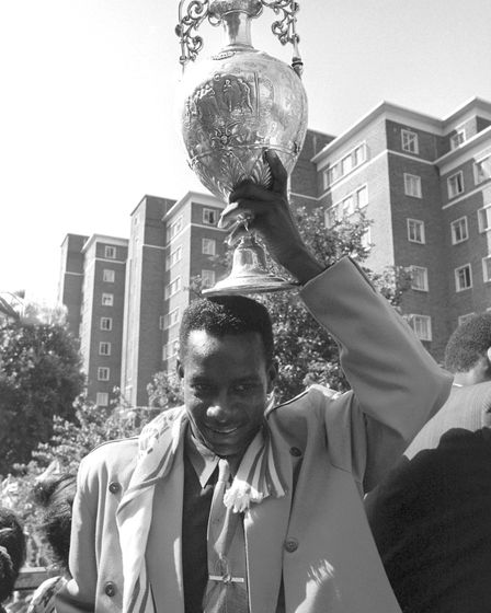 Arsenal midfielder Michael Thomas lifts the 1989 first division trophy at the Islington victory para