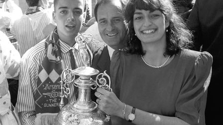 Arsenal manager George Graham, centre, shows off the first division trophy with his son Daniel, left