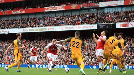 Arsenal's Nacho Monreal scores his side's first goal of the game during the Premier League match at