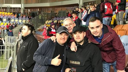 Arsenal supporters gather for a quick selfie before the game in Belarus
