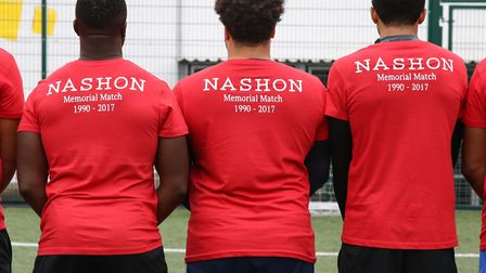 The red team line up before the match, wearing shirts commemorating Nashon Esbrand. Picture: Catheri
