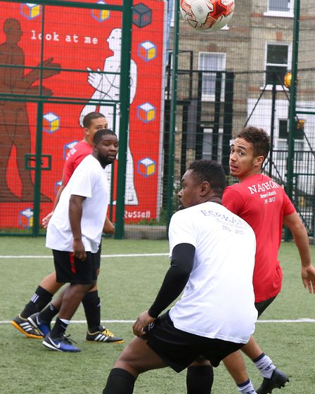 Friends and family of Nashon Esbrand play football to raise money for his funeral. Picture: Catherin