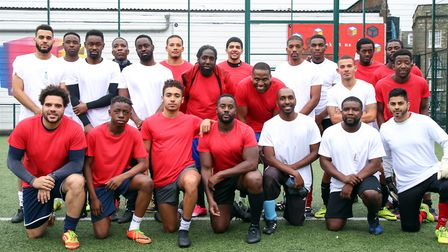 Friends and family of Nashon Esbrand before the football match played to raise money for his funeral
