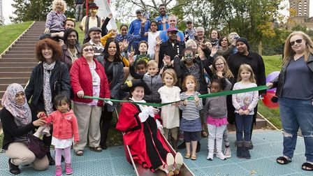 Mayor Cllr Una O'Halloran and local children enjoy the new slide at Archway Park. Picture: Steve Bai