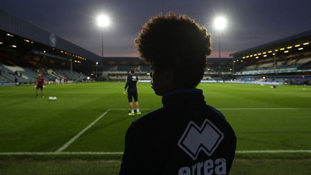 A ballboy watches on at Loftus Road, the home of Queens Park Rangers (pic: Jonathan Brady/PA)