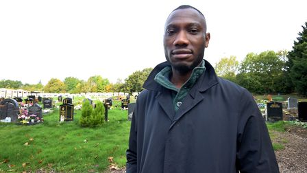 Gbenga Ajina at his wife's grave. Picture: Polly Hancock