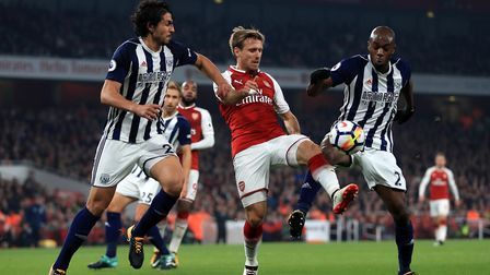 Arsenal's Nacho Monreal (centre) takes on West Bromwich Albion's Allan Nyom (right) and Ahmed Hegazy
