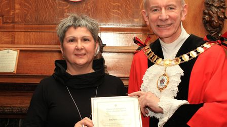 Michelle Lovell receiving a civic award from the mayor of Islington Cllr Barry Edwards.