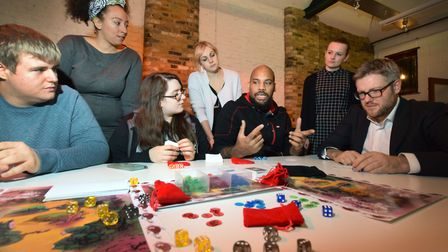 Games inventor Barrington Campbell explaining his strategy mythos table top game Koi with participa