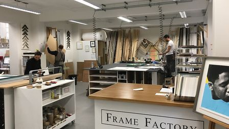 Framers at work in the Frame Factory. Picture: Daniel Lloyd