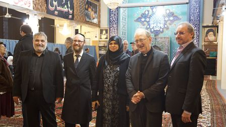 Yousif Khoei, Rabbi Baruch Levine, Aliya Azam and Rev. Lawrence Hillel at the Succah in Brondesbury