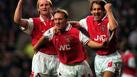 Paul Merson (right) celebrates a goal with Arsenal team-mates John Hartson and Lee Dixon (pic Owen H