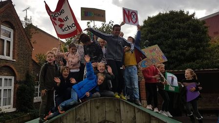 Students at Yerbury Primary School standing together in protest against education funding cuts.