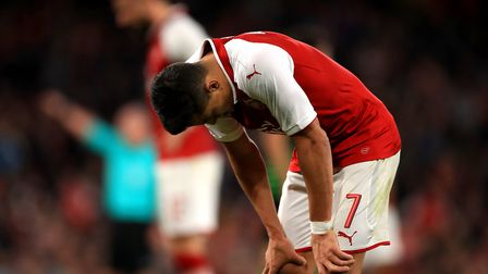 Arsenal's Alexis Sanchez reacts during the Carabao Cup, Third Round match at the Emirates Stadium, L