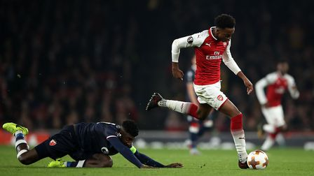 Red Star Belgrade's Mitchell Donald (left) and Arsenal's Joe Willock battle for the ball during the