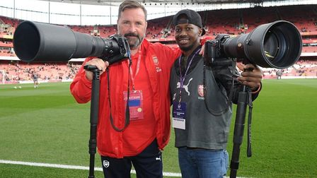 Victor and Arsenal club photographer Stuart MacFarlane pitchside at The Emirates.