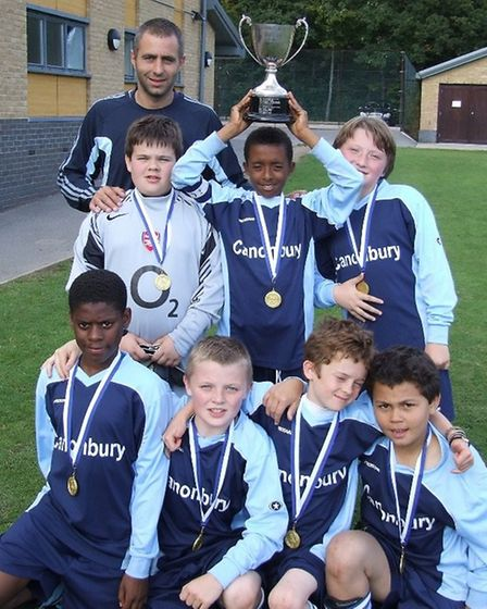 Canonbury Primary School celebrate winning the Forest Six-A-Side Cup with PE Teacher Scott Chickelda