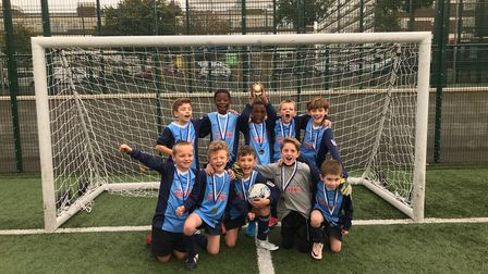 St Joan of Arc celebrate winning the Islington Primary School Cup for year three and four pupils