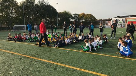 Pupils sit attentively at the Islington Primary Schools Cup event