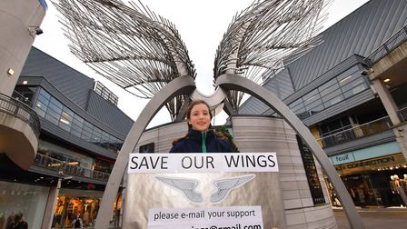 Olivia Gordon Clark, 10, is campaigning to save the 'beautiful' Angel Central wings sculpture. Pictu