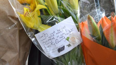 Flower tributes to Lee Jay Hatley at the Barnsbury Street entrance gates to Morland Mews, where he l