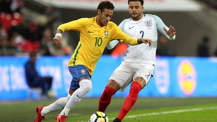 Brazil's Neymar (left) and England's Kyle Walker in action during the Bobby Moore Fund International
