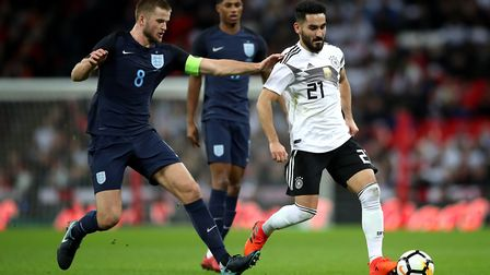 England's Eric Dier (left) and Germany's Ilkay Gundogan (right) battle for the ball during the Inter